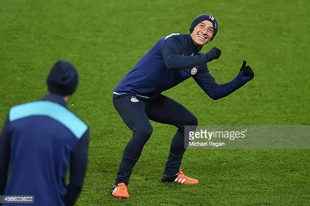 Andres Guardado of PSV Eindhoven looks on during the PSV Eindhoven training session at Old Trafford on November 24 2015 in Manchester England