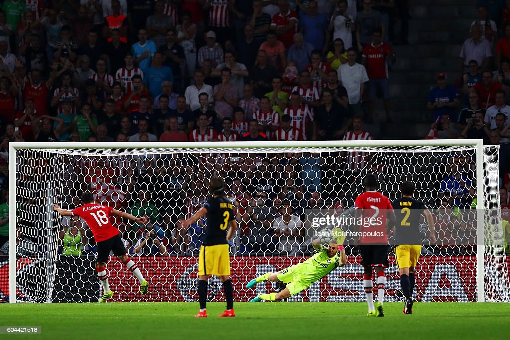 Andres Guardado of PSV Eindhoven takes a penalty which is saved by Jan Oblak of Atletico Madrid during the UEFA Champions League Group D match between PSV Eindhoven and Club Atletico de Madrid at Philips Stadion on September 13, 2016 in Eindhoven, Netherlands .