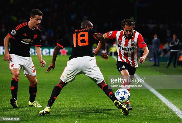 Andres Guardado of PSV Eindhoven takes on Ashley Young of Manchester United during the UEFA Champions League Group B match between PSV Eindhoven and...