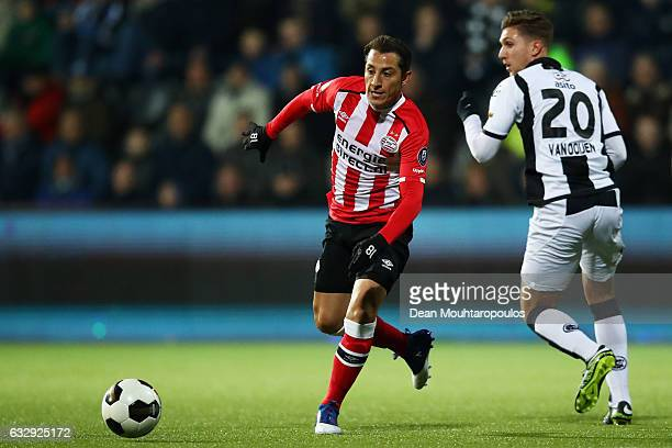 Andres Guardado of PSV gets past the tackle from Peter van Ooijen of Heracles Almelo during the Dutch Eredivisie match between Heracles Almelo and...