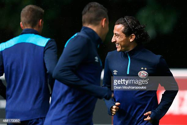 Andres Guardado of PSV laughs during the PSV Eindhoven training session held at De Herdgang on September 14 2015 in Eindhoven Netherlands PSV will...