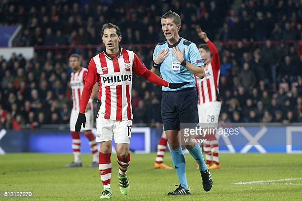 Andres Guardado of PSV Referee Daniele Orsato during the UEFA Champions League Round of 16 First leg match between PSV Eindhoven and Atletico Madrid...