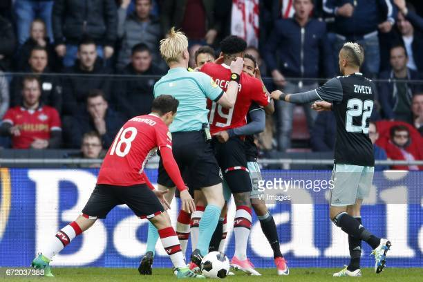 Andres Guardado of PSV Referee Kevin Blom Santiago Arias of PSV Jurgen Locadia of PSV Justin Kluivert of Ajax Hakim Ziyech of Ajaxduring the Dutch...