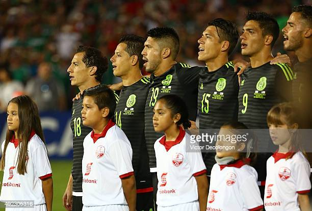 Andres Guardado#18 Javier Hernandez Oribe Peralta Hector Moreno Raul Jimenez and Diego Reyes of Mexico sing along to the Mexican national anthem...