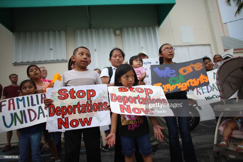 Andres Hemenez (L) and Martina Hemenez hold signs reading 'Stop Deportation Now' as they and others participate in a rally calling on President Barack Obama to immediately suspend deportations and for Congress to pass an immigration reform that's inclusive of all 11 million undocumented people in the U.S. on May 11, 2013 in Homestead, Florida. The rally is part of what is being called a rolling fast in different places throughout the nation over the course of the next two months to bring what organizers say is a moral, prophetic voice to the immigration debate.