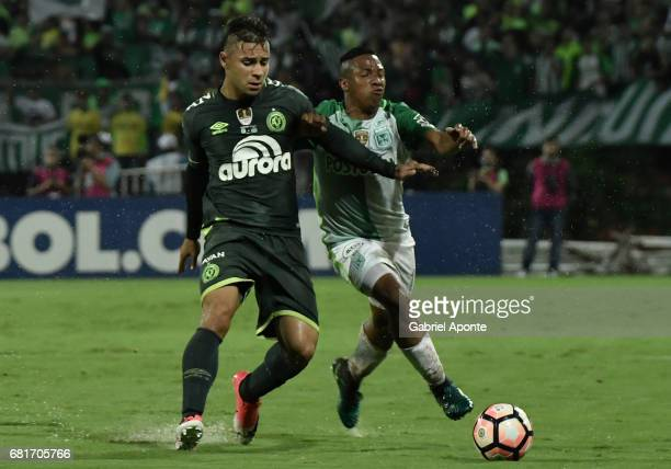 Andres Ibarguen of Nacional struggles for the ball with Joao Pedro of Chapecoense during a match between Atletico Nacional and Chapecoense as part of...