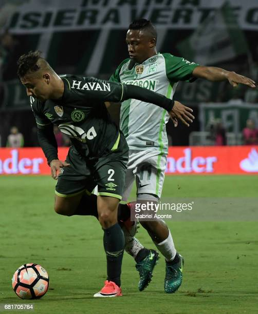 Andres Ibarguen of Nacional vies for the ball with Joao Pedro of Chapecoense during a match between Atletico Nacional and Chapecoense as part of...