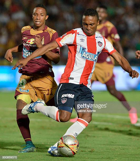 Andres Ibarguen of Tolima vies the ball with Ivan Velez of Junior during a first leg match between Deportes Tolima and Ateltico Junior as part of...