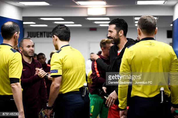 Andres Iniesta and Gianluigi Buffon during the UEFA Champions League group D match between Juventus and FC Barcelona at Allianz Stadium on November...