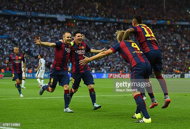 Andres Iniesta and Lionel Messi of Barcelona congratulate Ivan Rakitic after his opening goal during the UEFA Champions League Final between Juventus...