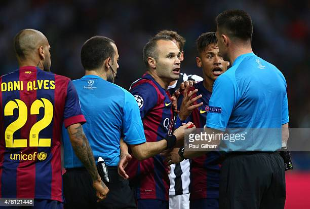 Andres Iniesta and Neymar of Barcelona confront referee Cuneyt Cakir and his assistant after a Neymar goal was disallowed during the UEFA Champions...