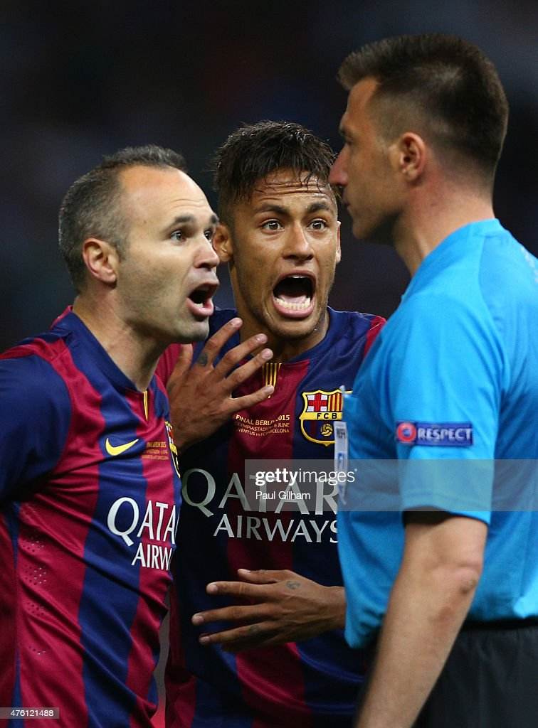 Andres Iniesta and Neymar of Barcelona confront the assistant referee after a Neymar goal was disallowed during the UEFA Champions League Final...