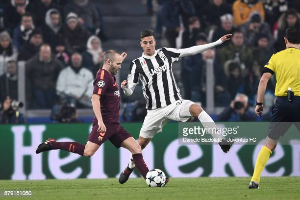 Andres Iniesta and Rodrigo Bentancur during the UEFA Champions League group D match between Juventus and FC Barcelona at Allianz Stadium on November...