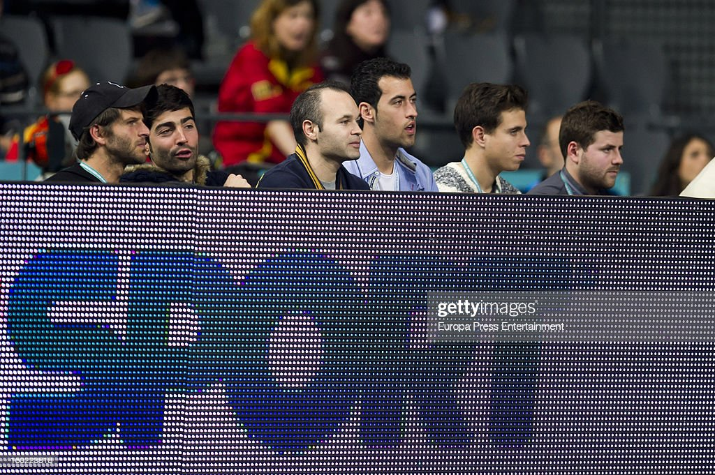 Andres Iniesta (3L) and Sergio Busquets (4L) attend the Men's Handball World Championship 2013 final match between Spain and Denmark at Palau Sant Jordi on January 27, 2013 in Barcelona, Spain.
