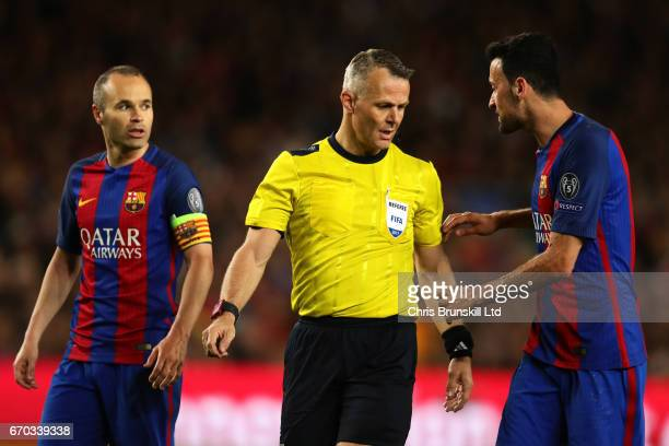 Andres Iniesta and Sergio Busquets of FC Barcelona speak to Referee Bjoern Kuipers during the UEFA Champions League Quarter Final second leg match...