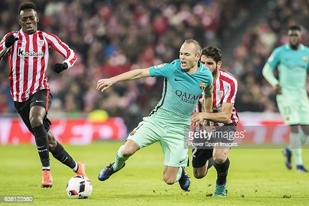 Andres Iniesta Lujan of FC Barcelona battles for the ball with Raul Garcia of Athletic Club during their Copa del Rey Round of 16 first leg match...