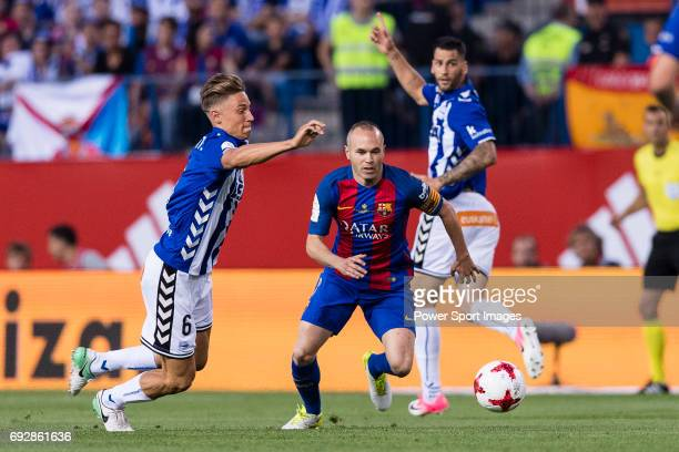 Andres Iniesta Lujan of FC Barcelona fights for the ball with Marcos Llorente of Deportivo Alaves during the Copa Del Rey Final between FC Barcelona...