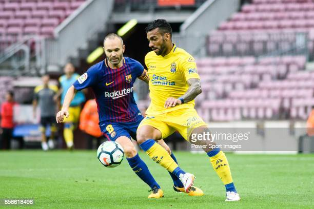 Andres Iniesta Lujan of FC Barcelona in action against Michel Macedo of UD Las Palmas during the La Liga 201718 match between FC Barcelona and Las...
