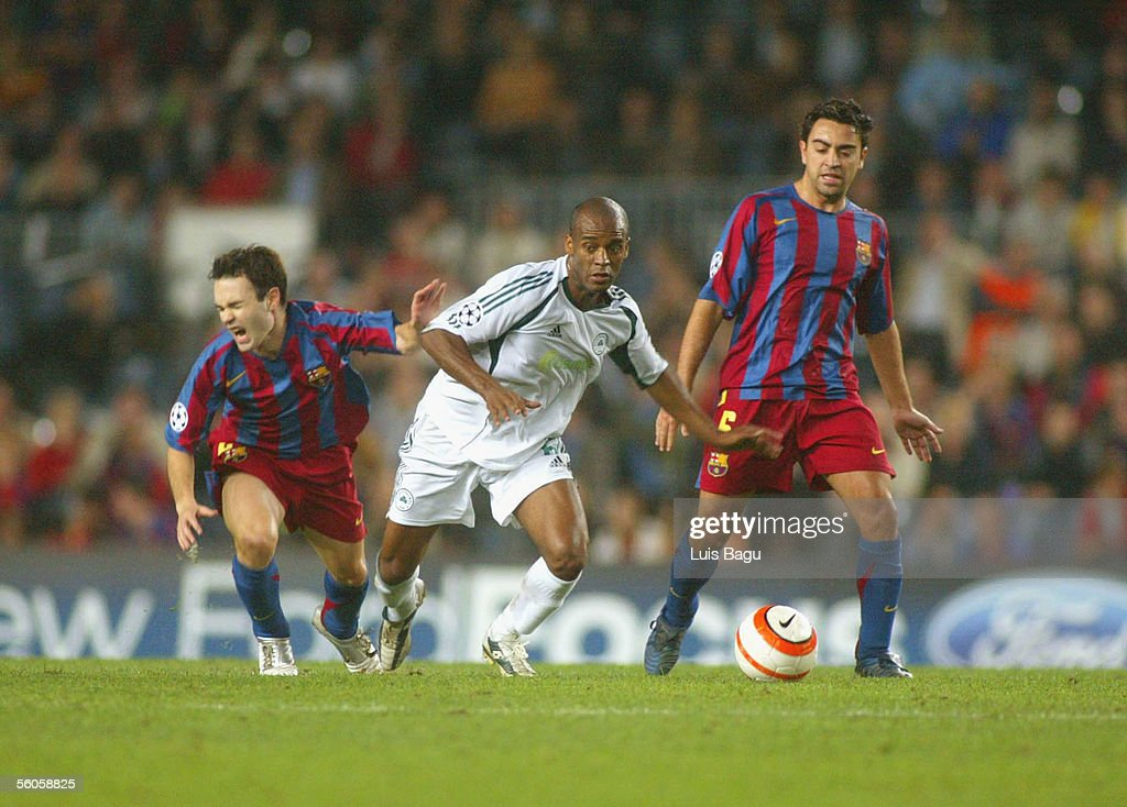 Andres Iniesta (L), Mark Van Bommel (R) of FC Barcelona and Flavio Conciencao of Panathinaikos in action during the UEFA Champions League group C match between FC Barcelona and Panathinaikos at the Camp Nou stadium on November 2, 2005 in in Barcelona, Spain.