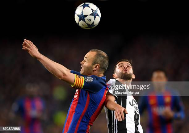 Andres Iniesta of Barcelona and Miralem Pjanic of Juventus battle to win a header during the UEFA Champions League Quarter Final second leg match...