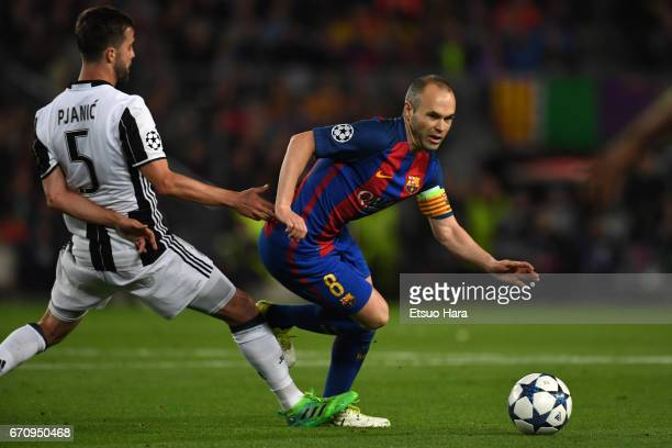 Andres Iniesta of Barcelona and Miralem Pjanic of Juventus compete for the ball during the UEFA Champions League Quarter Final second leg match...