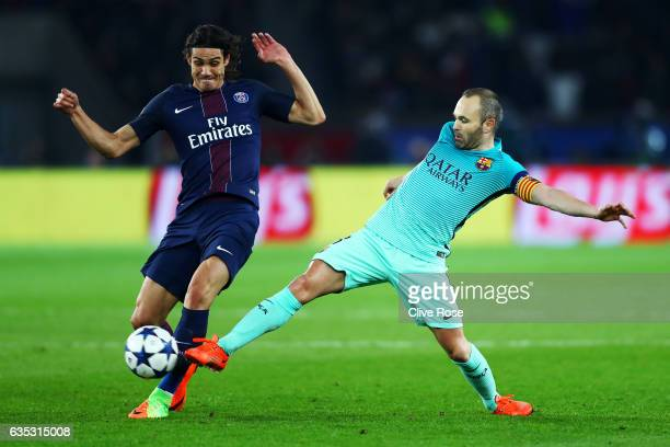 Andres Iniesta of Barcelona battles for the ball with Edinson Cavani of Paris SaintGermain during the UEFA Champions League Round of 16 first leg...