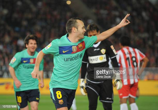 Andres Iniesta of Barcelona celebrates after scoring Barcelona's second goal during the La Liga match between UD Almeria and Barcelona at Estadio del...
