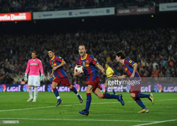 Andres Iniesta of Barcelona celebrates scoring his sides equalizing goal during the La Liga match between Barcelona and Valencia at the Camp Nou...