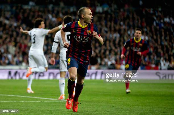Andres Iniesta of Barcelona celebrates scoring the opening goal during the La Liga match between Real Madrid CF and FC Barcelona at the Bernabeu on...