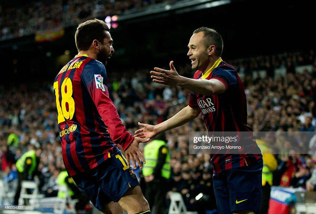 Andres Iniesta (R) of Barcelona celebrates scoring the opening goal with <a gi-track='captionPersonalityLinkClicked' href=/galleries/search?phrase=Jordi+Alba&family=editorial&specificpeople=5437949 ng-click='$event.stopPropagation()'>Jordi Alba</a> of Barcelona during the La Liga match between Real Madrid CF and FC Barcelona at the Bernabeu on March 23, 2014 in Madrid, Spain.