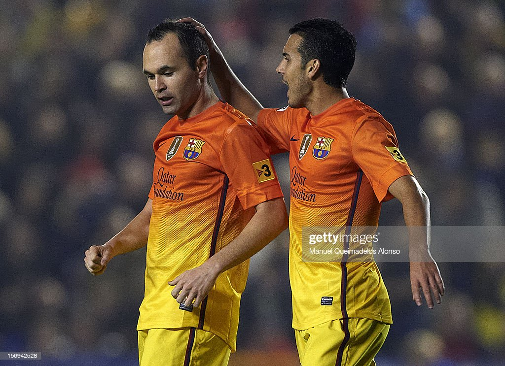 <a gi-track='captionPersonalityLinkClicked' href=/galleries/search?phrase=Andres+Iniesta&family=editorial&specificpeople=465707 ng-click='$event.stopPropagation()'>Andres Iniesta</a> (L) of Barcelona celebrates scoring with his teammate Pedro Rodriguez during the la Liga match between Levante UD and FC Barcelona at Ciutat de Valencia on November 25, 2012 in Valencia, Spain.