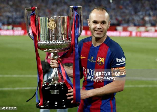 Andres Iniesta of Barcelona celebrates with the trophy after the Copa Del Rey Final between FC Barcelona and Deportivo Alaves at Vicente Calderon...