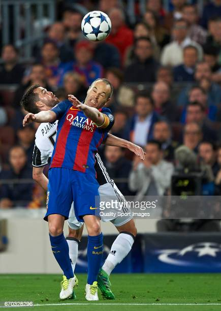 Andres Iniesta of Barcelona competes for the ball with Miralem Pjanic of Juventus during the UEFA Champions League Quarter Final second leg match...