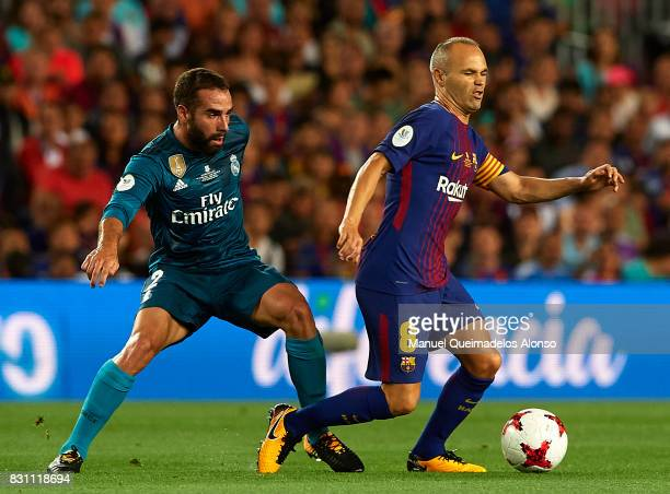 Andres Iniesta of Barcelona is tackled by Daniel Carvajal of Real Madrid during the Supercopa de Espana Supercopa Final 1st Leg match between FC...