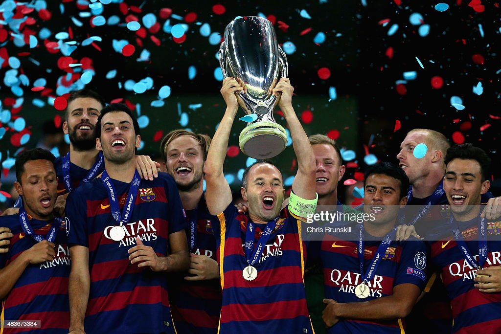<a gi-track='captionPersonalityLinkClicked' href=/galleries/search?phrase=Andres+Iniesta&family=editorial&specificpeople=465707 ng-click='$event.stopPropagation()'>Andres Iniesta</a> of Barcelona lifts the UEFA Cup trophy as Barcelona celebrate victoy during the UEFA Super Cup between Barcelona and Sevilla FC at Dinamo Arena on August 11, 2015 in Tbilisi, Georgia.