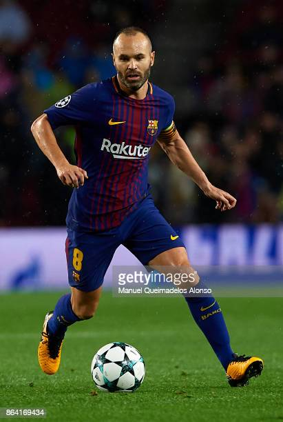 Andres Iniesta of Barcelona runs with the ball during the UEFA Champions League group D match between FC Barcelona and Olympiakos Piraeus at Camp Nou...