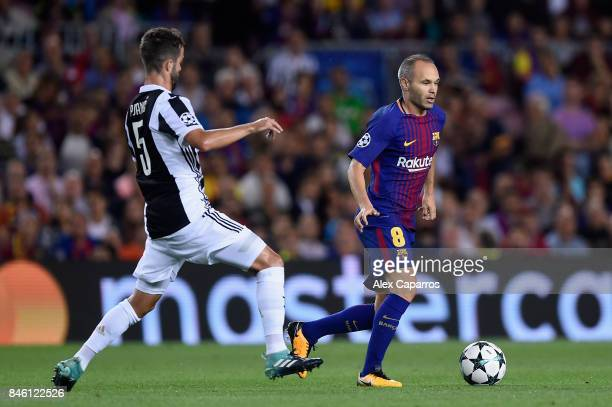 Andres Iniesta of Barcelona takes the ball away from Miralem Pjanic of Juventus during the UEFA Champions League Group D match between FC Barcelona...