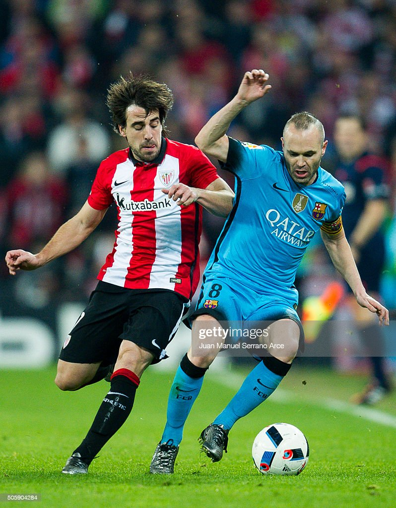 <a gi-track='captionPersonalityLinkClicked' href=/galleries/search?phrase=Andres+Iniesta&family=editorial&specificpeople=465707 ng-click='$event.stopPropagation()'>Andres Iniesta</a> of FC Barcelola duels for the ball with <a gi-track='captionPersonalityLinkClicked' href=/galleries/search?phrase=Benat+Etxebarria&family=editorial&specificpeople=8282511 ng-click='$event.stopPropagation()'>Benat Etxebarria</a> of Athletic Club during the Copa del Rey Quarter Final First Leg match between Athletic Club and FC Barcelola at San Mames Stadium on January 20, 2016 in Bilbao, Spain.