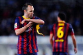 Andres Iniesta of FC Barcelona adjusts the Captain armband as his teammate Xavi Hernandez of FC Barcelona leaves the pitch during the Copa del Rey...