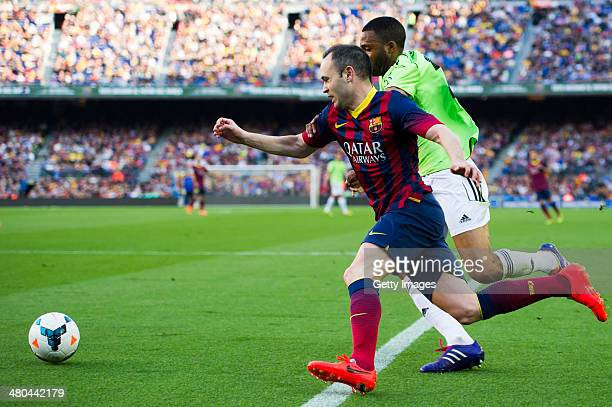 Andres Iniesta of FC Barcelona and Jordan Loties of CA Osasuna fight for the ball during the La Liga match between FC Barcelona and CA Osasuna at...