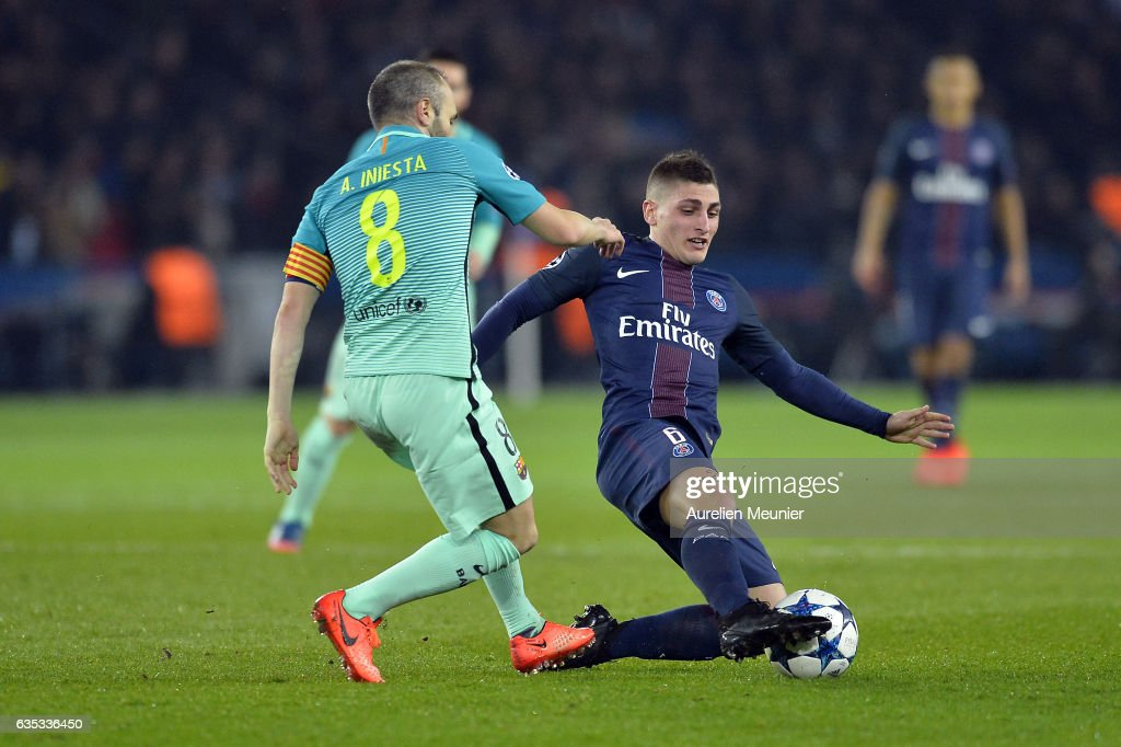Andres Iniesta of FC Barcelona and Marco Verratti of Paris-Saint Germain fight for the ball during the UEFA Champions League Round of 16 first leg match between Paris Saint-Germain and FC Barcelona at Parc des Princes on February 14, 2017 in Paris, France.
