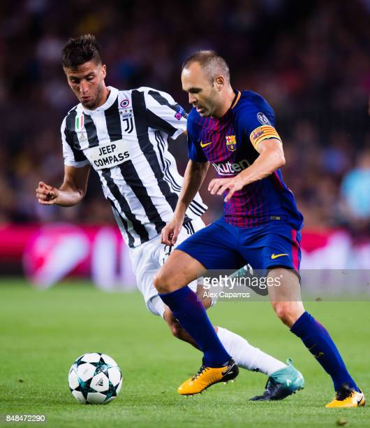 Andres Iniesta of FC Barcelona and Rodrigo Bentancur of Juventus battle for possession during the UEFA Champions League group D match between FC...