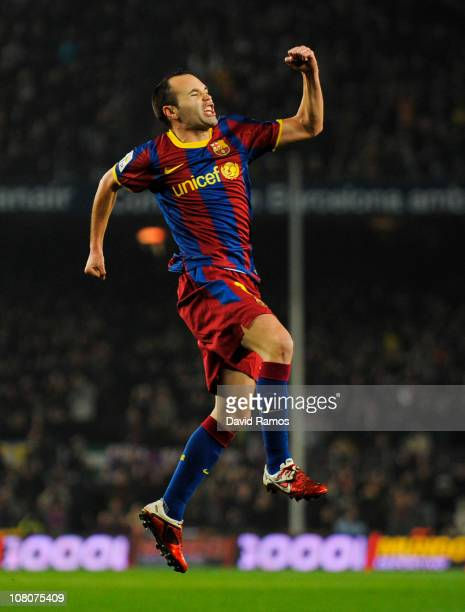 Andres Iniesta of FC Barcelona celebrates after scoring his side's first goal during the La Liga match between FC Barcelona and Malaga at Nou Camp on...