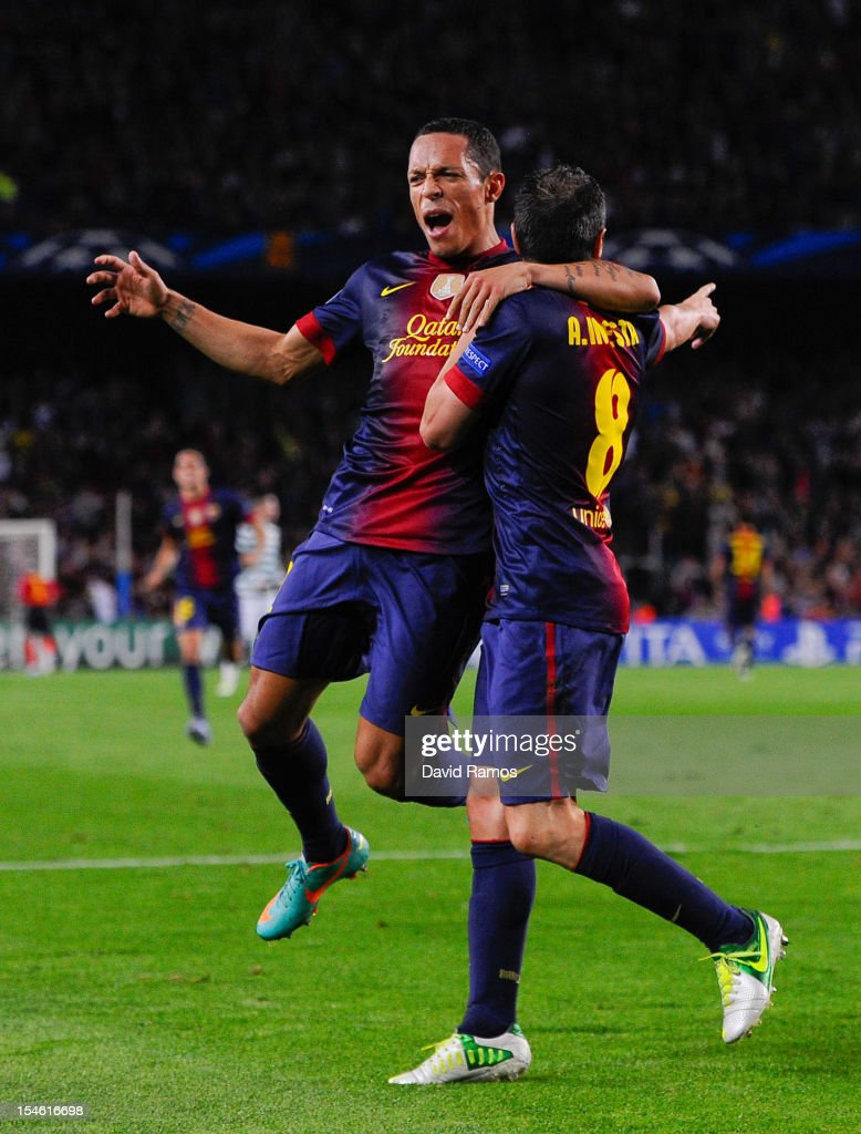 <a gi-track='captionPersonalityLinkClicked' href=/galleries/search?phrase=Andres+Iniesta&family=editorial&specificpeople=465707 ng-click='$event.stopPropagation()'>Andres Iniesta</a> of FC Barcelona (R) celebrates with his teammate <a gi-track='captionPersonalityLinkClicked' href=/galleries/search?phrase=Adriano+-+Soccer+Defender+and+Midfielder+-+Born+1984&family=editorial&specificpeople=640788 ng-click='$event.stopPropagation()'>Adriano</a> Correia after scoring his team's first goal goal during the UEFA Champions League Group G match between FC Barcelona and Celtic FC at the Camp Nou Stadium on October 23, 2012 in Barcelona, Spain.