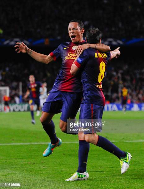 Andres Iniesta of FC Barcelona celebrates with his teammate Adriano Correia after scoring his team's first goal goal during the UEFA Champions League...