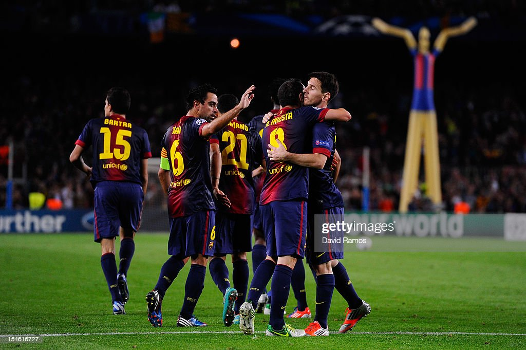 <a gi-track='captionPersonalityLinkClicked' href=/galleries/search?phrase=Andres+Iniesta&family=editorial&specificpeople=465707 ng-click='$event.stopPropagation()'>Andres Iniesta</a> of FC Barcelona (2ndR) celebrates with his teammates after scoring his team's first goal goal during the UEFA Champions League Group G match between FC Barcelona and Celtic FC at the Camp Nou Stadium on October 23, 2012 in Barcelona, Spain.