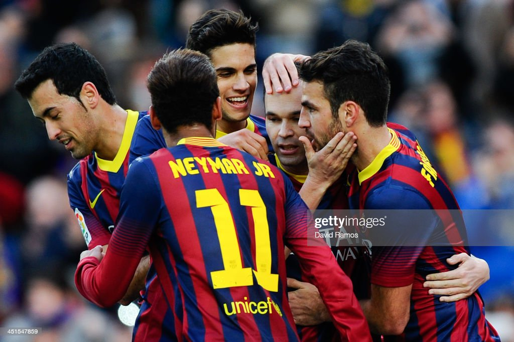 <a gi-track='captionPersonalityLinkClicked' href=/galleries/search?phrase=Andres+Iniesta&family=editorial&specificpeople=465707 ng-click='$event.stopPropagation()'>Andres Iniesta</a> (2ndR) of FC Barcelona celebrates with his teammates after scoring the opening goal from the penalty spot during the La Liga match between FC Barcelona and Granda CF at Camp Nou on November 23, 2013 in Barcelona, Spain.