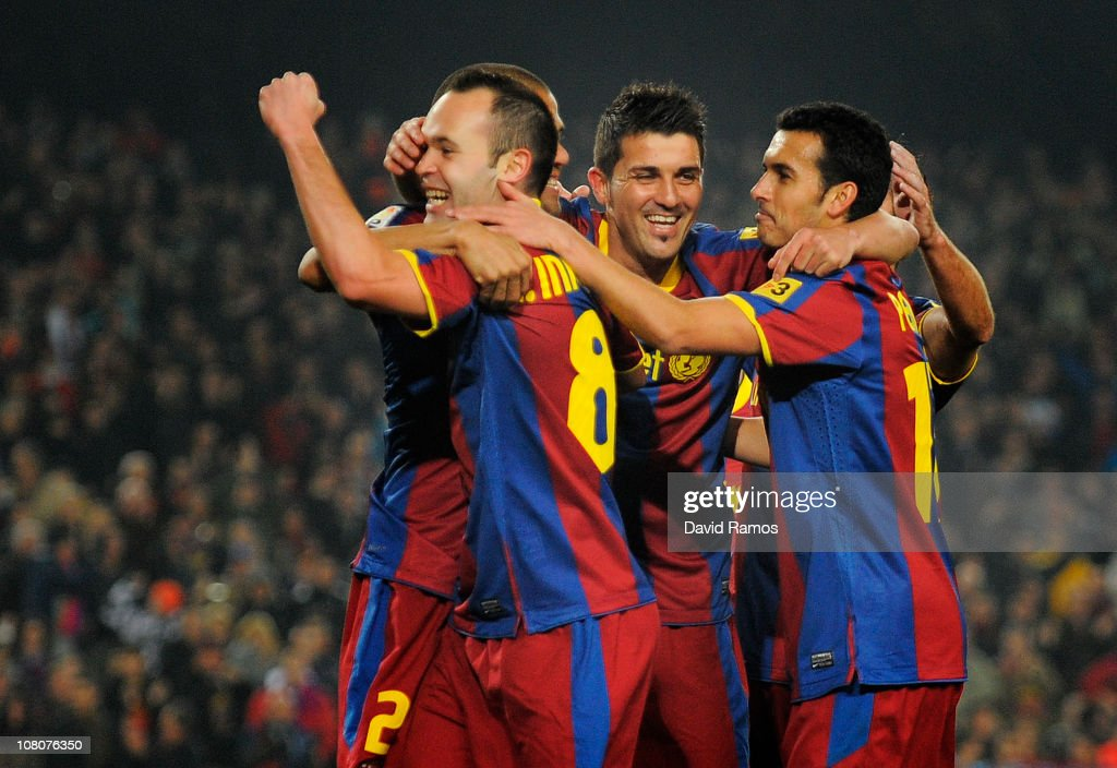 <a gi-track='captionPersonalityLinkClicked' href=/galleries/search?phrase=Andres+Iniesta&family=editorial&specificpeople=465707 ng-click='$event.stopPropagation()'>Andres Iniesta</a> of FC Barcelona (L) celebrates with his teammates <a gi-track='captionPersonalityLinkClicked' href=/galleries/search?phrase=David+Villa&family=editorial&specificpeople=467566 ng-click='$event.stopPropagation()'>David Villa</a> (C) and Pedro Rodriguez (R) after scoring his side's first goal during the La Liga match between FC Barcelona and Malaga at Nou Camp on January 16, 2011 in Barcelona, Spain.
