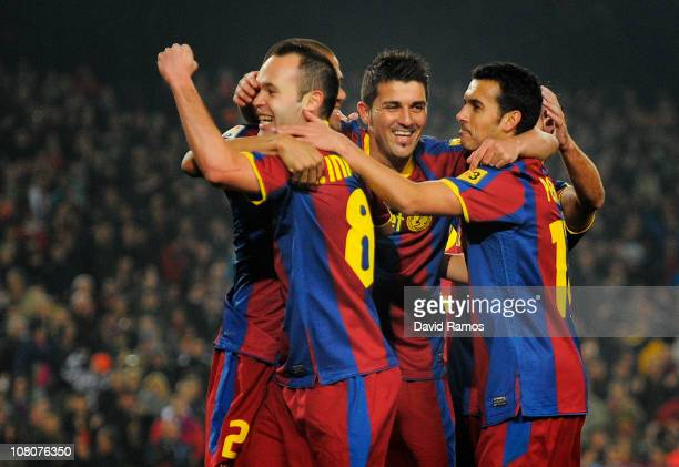 Andres Iniesta of FC Barcelona celebrates with his teammates David Villa and Pedro Rodriguez after scoring his side's first goal during the La Liga...