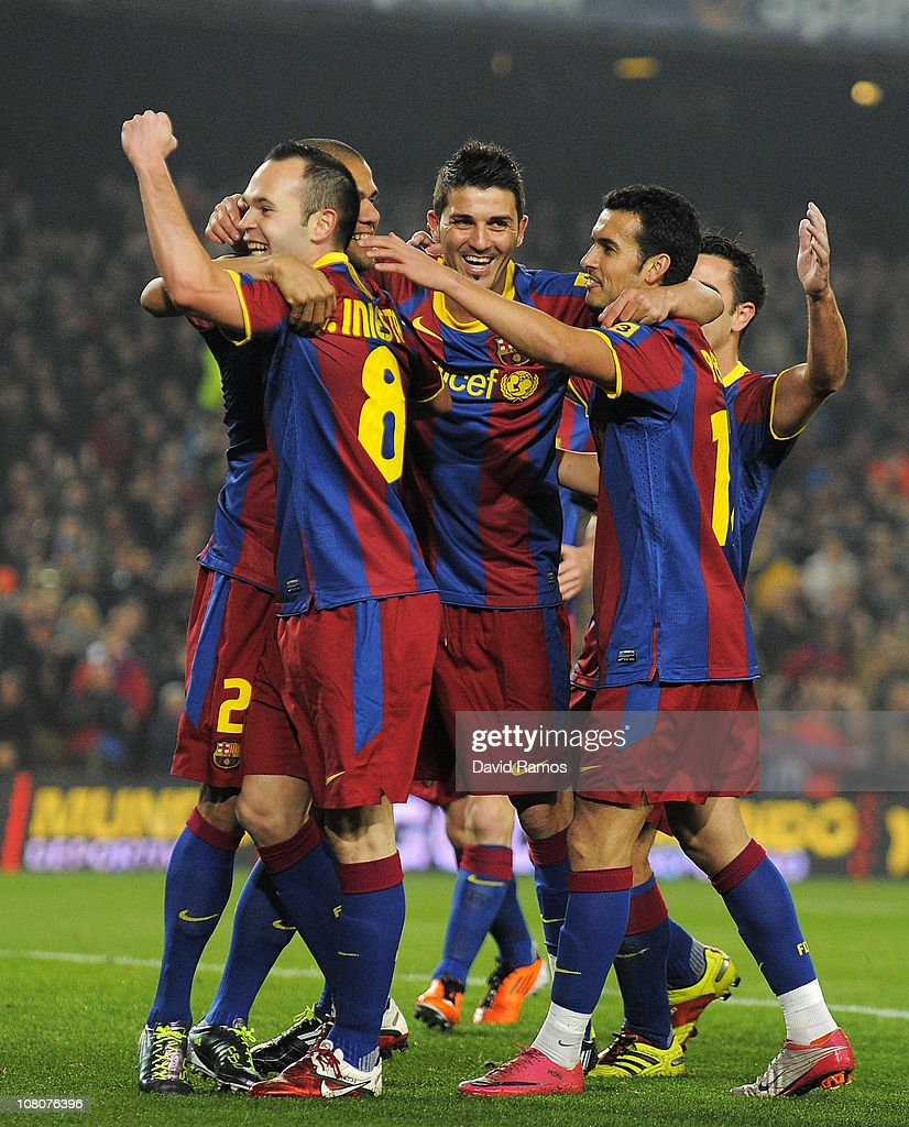 <a gi-track='captionPersonalityLinkClicked' href=/galleries/search?phrase=Andres+Iniesta&family=editorial&specificpeople=465707 ng-click='$event.stopPropagation()'>Andres Iniesta</a> of FC Barcelona (L) celebrates with his teammates <a gi-track='captionPersonalityLinkClicked' href=/galleries/search?phrase=David+Villa&family=editorial&specificpeople=467566 ng-click='$event.stopPropagation()'>David Villa</a> (C) and Pedro Rodriguez (R) after scoring his side's first goal during the La Liga match between FC Barcelona and Malaga at Nou Camp on January 16, 2011 in Barcelona, Spain. Barcelona won 4-1.
